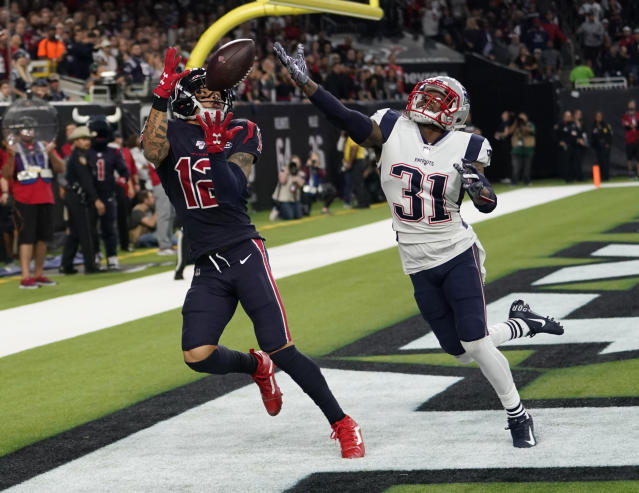 Houston Texans wide receiver Kenny Stills (12) pulls in a pass in front of New England Patriots cornerback Jonathan Jones (31) for a touchdown during the second half of an NFL football game Sunday, Dec. 1, 2019, in Houston. (AP Photo/David J. Phillip)