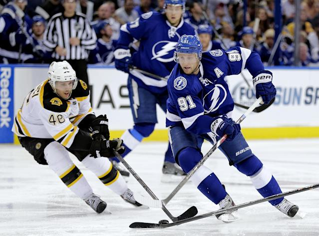 Tampa Bay Lightning center Steven Stamkos (91) cuts in front of Boston Bruins center David Krejci (46), of the Czech Republic, during the second period of an NHL hockey game Saturday, Oct. 19, 2013, inTampa, Fla. (AP Photo/Chris O'Meara)