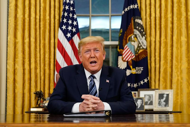 "US President Donald Trump addresses the Nation from the Oval Office about the widening novel coronavirus (Covid-19) crisis in Washington, DC on March 11, 2020. - President Donald Trump announced on March 11, 2020 the United States would ban all travel from Europe for 30 days starting to stop the spread of the coronavirus outbreak. ""To keep new cases from entering our shores, we will be suspending all travel from Europe to the United States for the next 30 days. The new rules will go into effect Friday at midnight,"" Trump said in an address to the nation. (Photo by Doug Mills / POOL / AFP) (Photo by DOUG MILLS/POOL/AFP via Getty Images)"