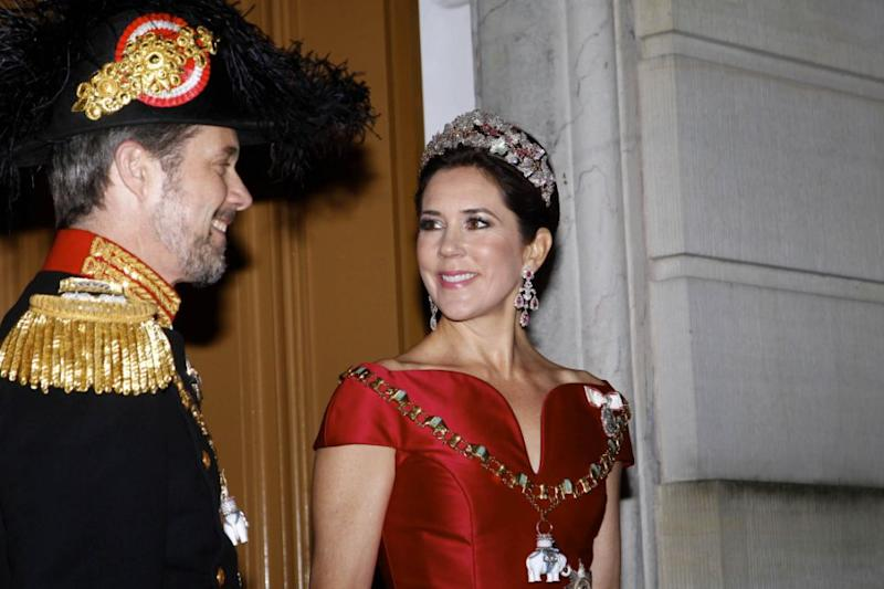 The mum-of-four looked at her dashing husband, Prince Frederik, as they entered the party. Photo: Australscope