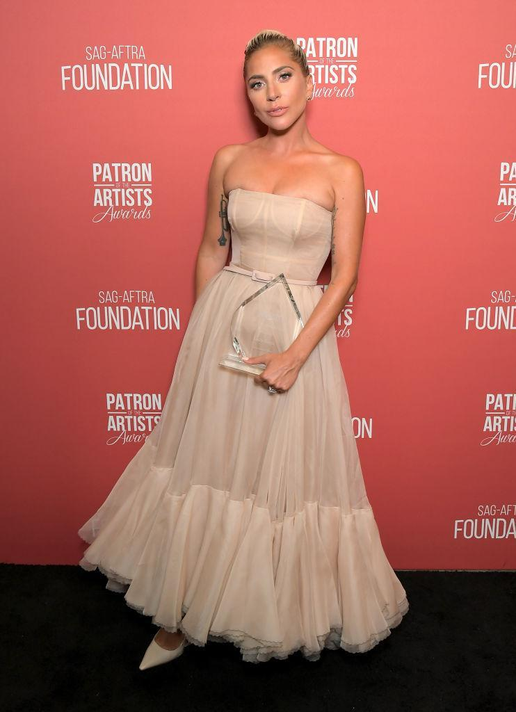 <p>On November 8, Lady Gaga wore a cold-shoulder dress by Christian Dior (complete with a glowing tan) for a star-studded event in Beverly Hills. <em>[Photo: Getty]</em> </p>