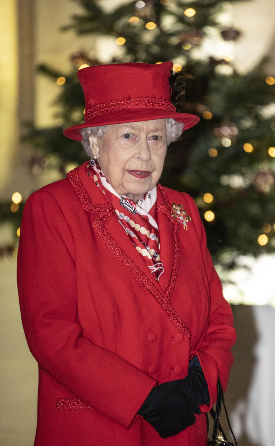 WINDSOR, ENGLAND - DECEMBER 08: Queen Elizabeth II thanks volunteers and key workers at Windsor Castle on December 08, 2020 in Windsor, England. The Queen and members of the royal family gave thanks to local volunteers and key workers for their work in helping others during the coronavirus pandemic and over Christmas at Windsor Castle in what was also the final stop for the Duke and Duchess of Cambridge on their tour of England, Wales and Scotland. (Photo by Richard Pohle - WPA Pool/Getty Images)