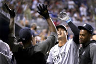 New York Yankees' Anthony Rizzo celebrates in the dugout after hitting a solo home tun during the sixth inning of the team's baseball game against the Miami Marlins, Friday, July 30, 2021, in Miami. (AP Photo/Lynne Sladky)