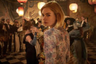 """This image released by Netflix shows Lily James from the film """"Rebecca,"""" premiering Wednesday on Netflix. (Kerry Brown/Netflix via AP)"""