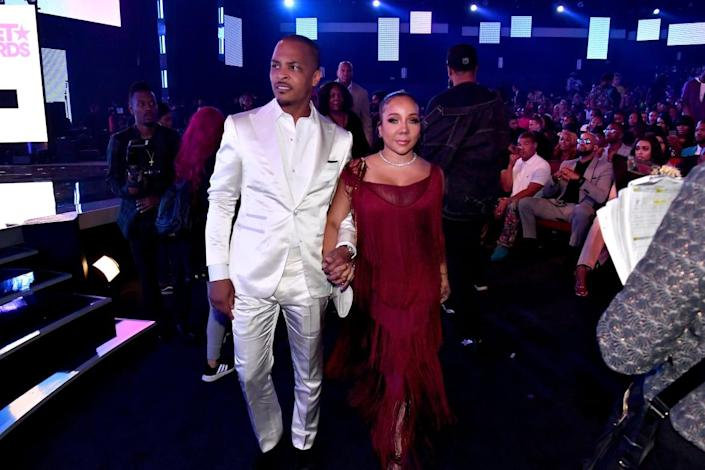"""<div class=""""inline-image__caption""""><p>T.I. and Tameka """"Tiny"""" Harris seen in the audience at the 2019 BET Awards at Microsoft Theater on June 23, 2019, in Los Angeles, California. </p></div> <div class=""""inline-image__credit"""">Paras Griffin/Getty</div>"""