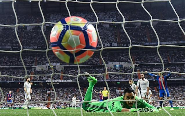 <span>Keylor Navas looks on in despair as Messi's last-minute shot goes in</span> <span>Credit: Getty Images </span>