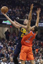 Cleveland Cavaliers' Kevin Love (0) shoots against Oklahoma City Thunder's Darius Bazley (7) in the first half of an NBA basketball game, Saturday, Jan. 4, 2020, in Cleveland. (AP Photo/Tony Dejak)