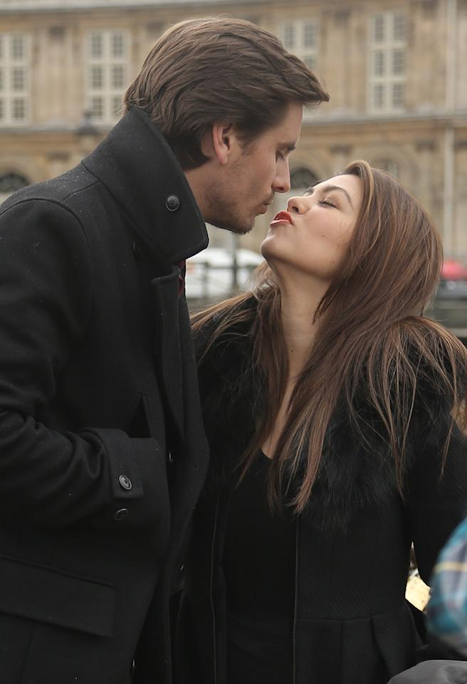 "Kourtney Kardashian gets romantic on bridge with Scott Disick as Mason plays on a bridge in Paris. The happy family even made a vow to each other to 'lock up' their love literally by using a lock and key and connecting to the bridge. Scott then threw the key in the water and said ""I think it's forever now baby!"" as Kourtney went in for a kiss. They then took a photo together of their lock.