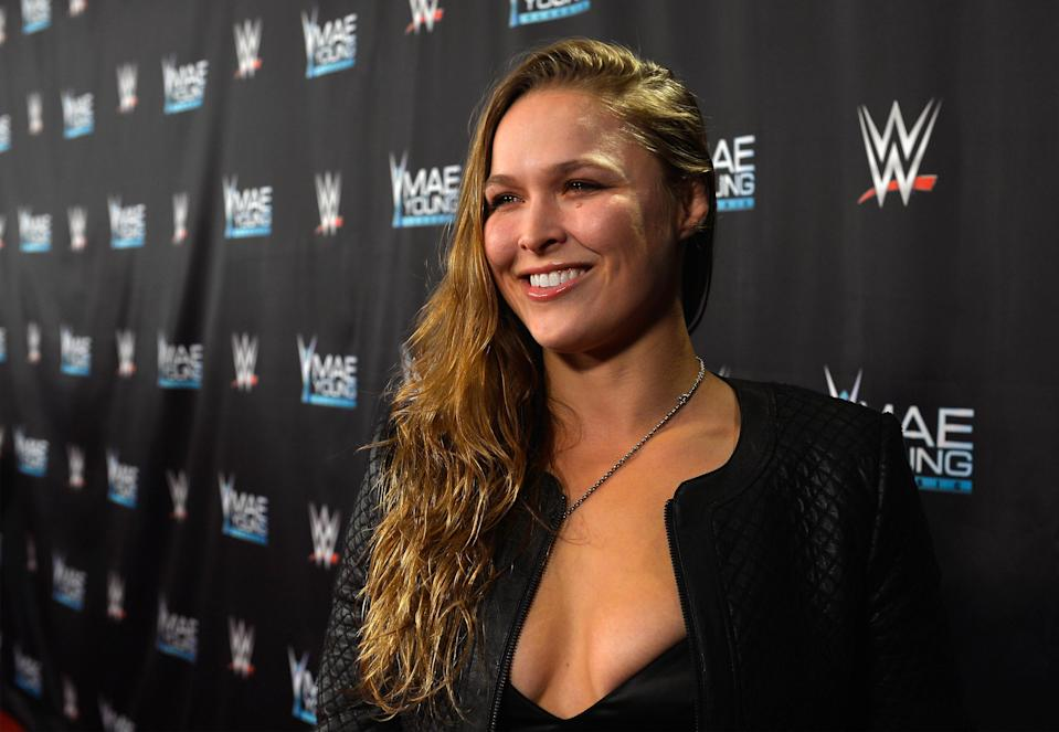 Ronda Rousey's dinner with Triple H fueled speculation of transition to WWE ring.