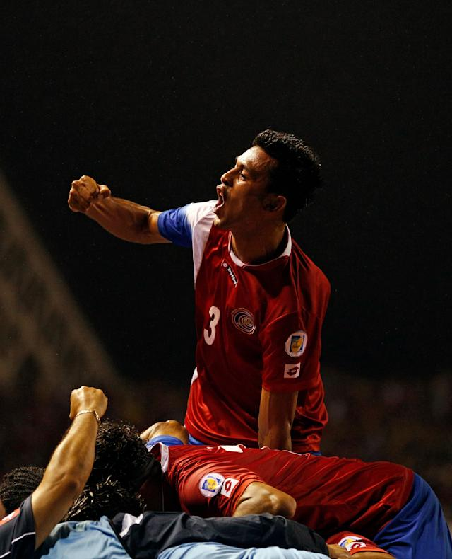 Costa Rica's Giancarlo Gonzalez celebrates after teammate Alvaro Saborio scored a goal against Mexico during a 2014 World Cup qualifying soccer match in San Jose, Costa Rica, Tuesday, Oct. 15, 2013. (AP Photo/Moises Castillo)