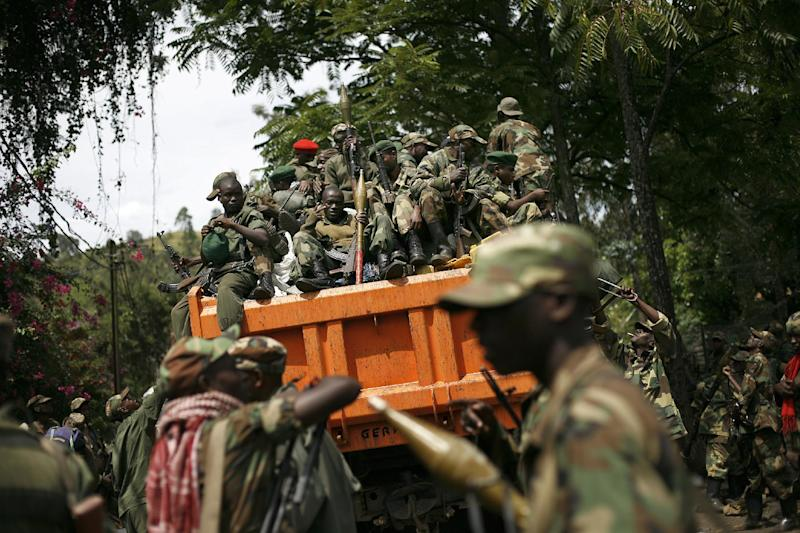 FILE - In this Dec. 1, 2012 file photo, M23 rebels sit in a vehicle as they withdraw from the eastern Congo town of Goma. Eleven African countries signed a United Nations-drafted peace deal on Sunday, Feb. 24, 2013, to stabilize the troubled Central African country of Congo, where rebels allegedly backed by neighboring countries last year threatened to oust the government. Congo's neighbors collectively promised not to interfere in the internal affairs of the Congo or to tolerate or support armed groups. A U.N. report last year said that Rwanda and Uganda helped aid M23 rebels inside Congo. The two countries denied the allegations.(AP Photo/Jerome Delay, File)