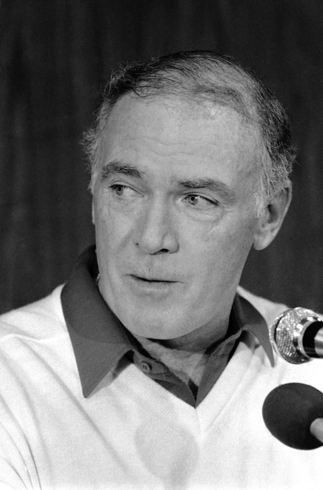 FILE - In this Dec. 31, 1983 file photo Seattle Seahawks coach Chuck Knox listening during a news conference in Miami. Knox, the veteran NFL coach who led the Seattle Seahawks for nine years and took the Los Angeles Rams to three straight NFC championship games, has died. He was 86. Knox died Saturday evening, the Seahawks confirmed Sunday, May 13, 2018. (AP Photo/Kathy Willens, file)