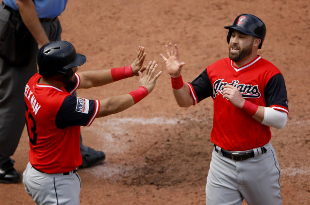Cleveland Indians' Melky Cabrera, left, and Jason Kipnis celebrate after scoring on a two-run single by Francisco Lindor during the sixth inning of a baseball game against the Kansas City Royals, Sunday, Aug. 26, 2018, in Kansas City, Mo. (AP Photo/Charlie Riedel)