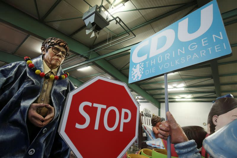 A papier mache figure for carnival floats depicting Annegret Kramp-Karrenbauer, outgoing leader of the Christian Democratic Union (CDU), is pictured during preparations for the upcoming Rose Monday carnival parade in Mainz