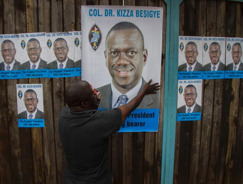 Posters of Ugandan opposition leader Kizza Besigye are put up at the Forum for Democratic Change (FDC) offices in Kampala on July 1, 2015 (AFP Photo/Isaac Kasamani)