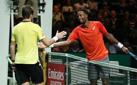 Tennis - ATP 500 - Rotterdam Open - Rotterdam Ahoy, Rotterdam, Netherlands - February 17, 2019 France's Gael Monfils shakes hands with Switzerland's Stan Wawrinka after winning their Final match REUTERS/Yves Herman