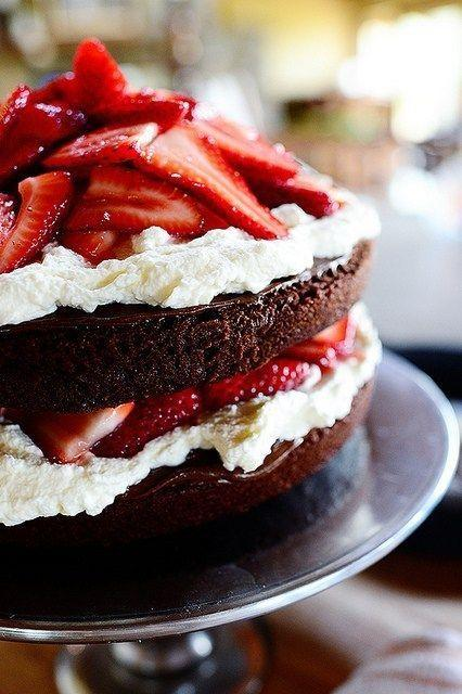 """<p>Mix up your usual 4th of July dessert table and try this rich, tiered cake. </p><p><strong><a href=""""https://thepioneerwoman.com/cooking/chocolate-strawberry-nutella-cake/"""" rel=""""nofollow noopener"""" target=""""_blank"""" data-ylk=""""slk:Get the recipe."""" class=""""link rapid-noclick-resp"""">Get the recipe.</a></strong></p><p><strong><a class=""""link rapid-noclick-resp"""" href=""""https://go.redirectingat.com?id=74968X1596630&url=https%3A%2F%2Fwww.walmart.com%2Fip%2FThe-Pioneer-Woman-9-Floral-Round-Cake-Pan%2F170120502&sref=https%3A%2F%2Fwww.thepioneerwoman.com%2Ffood-cooking%2Fmeals-menus%2Fg32109085%2Ffourth-of-july-desserts%2F"""" rel=""""nofollow noopener"""" target=""""_blank"""" data-ylk=""""slk:SHOP CAKE PANS"""">SHOP CAKE PANS</a><br></strong></p>"""