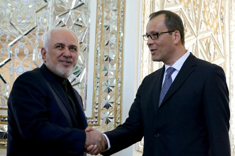 Iranian Foreign Minister Mohammad Javad Zarif (left) welcomes Cornel Feruta, acting head of the UN atomic watchdog, upon his arrival in Tehran in September 2019 (AFP Photo/ATTA KENARE)