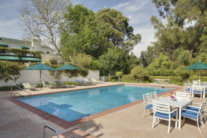 <p>The grounds also include this old Hollywood-style pool, with a nearby pool house with a food prep station.</p>
