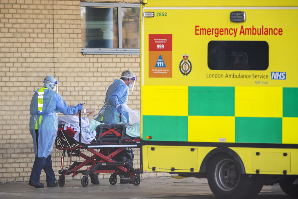 LONDON, UNITED KINGDOM - APRIL 21: NHS workers in PPE take a patient with an unknown condition to an ambulance at Queens Hospital on April 21, 2020 in London, England. The British government has extended the lockdown restrictions first introduced on March 23 that are meant to slow the spread of COVID-19. (Photo by Justin Setterfield/Getty Images)