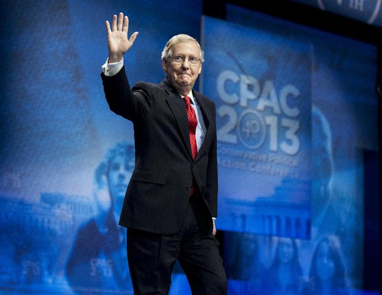 FILE - In this March 15, 2013, file photo, Senate Minority Leader Mitch McConnell, R-Ky., waves as he arrives to speak at the 40th annual Conservative Political Action Conference in National Harbor, Md. (AP Photo/Manuel Balce Ceneta, File)