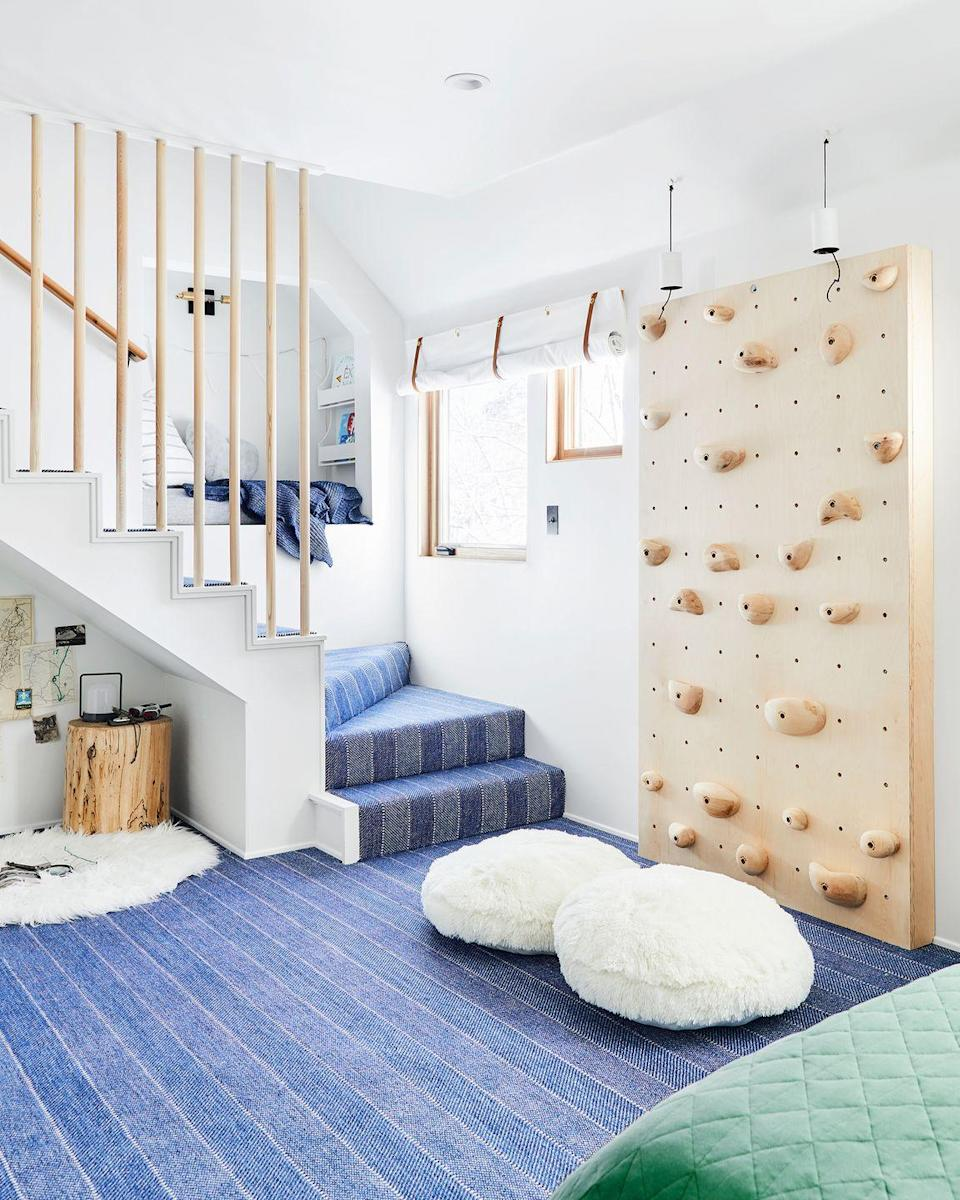 <p>Hello, playroom of our dreams. Designed by Emily Henderson, every little nook and cranny is being optimized in this fun-filled space. The pint-sized built-in hang out in the stairwell and the zone under the stairs are transformed into cozy, useable, and stylish sections. Then there's the climbing wall. The neutral tones ensure a more stylish aesthetic and the strategically-placed floor cushions lighten things up. </p>