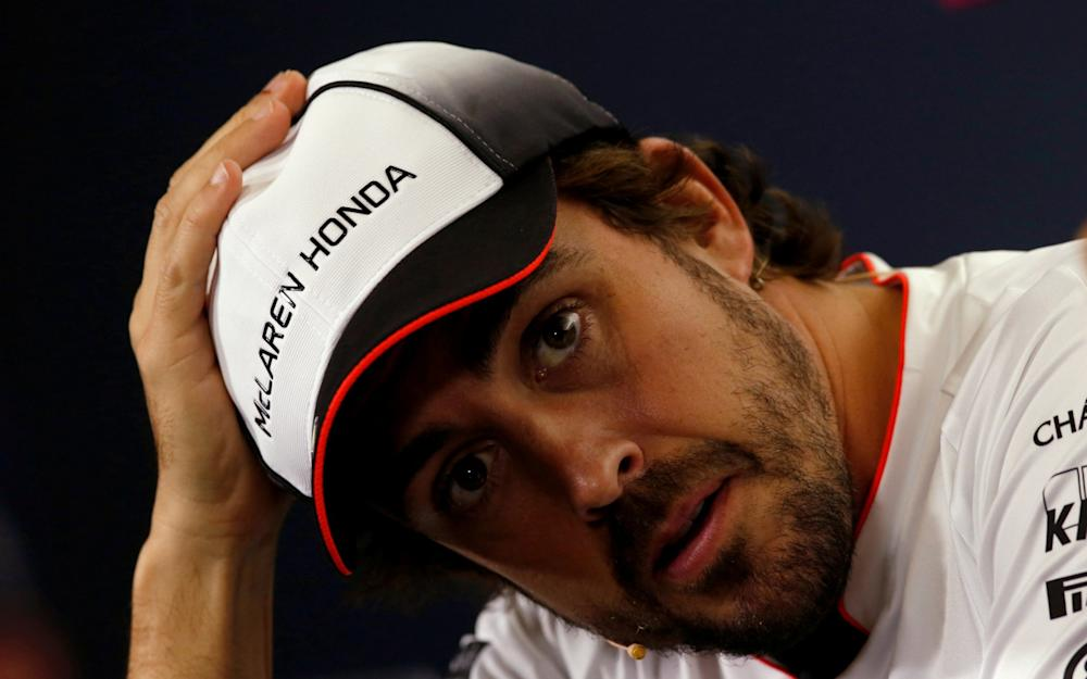 FILE PHOTO: Formula One - Spanish Grand Prix - Barcelona-Catalunya racetrack, Montmelo, Spain - 12/5/16. McLaren's F1 driver Fernando Alonso gestures during a news conference ahead of the Spanish Grand Prix. REUTERS/Albert Gea/File Photo - Credit: Albert Gea/REUTERS