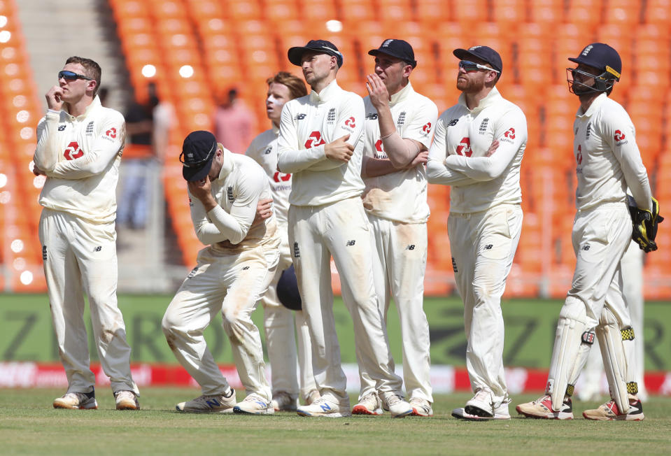 England's Dominic Bess, left, and teammates react after losing the review for the wicket of India's Rishabh Pant during the second day of fourth cricket test match between India and England at Narendra Modi Stadium in Ahmedabad, India, Friday, March 5, 2021. (AP Photo/Aijaz Rahi)