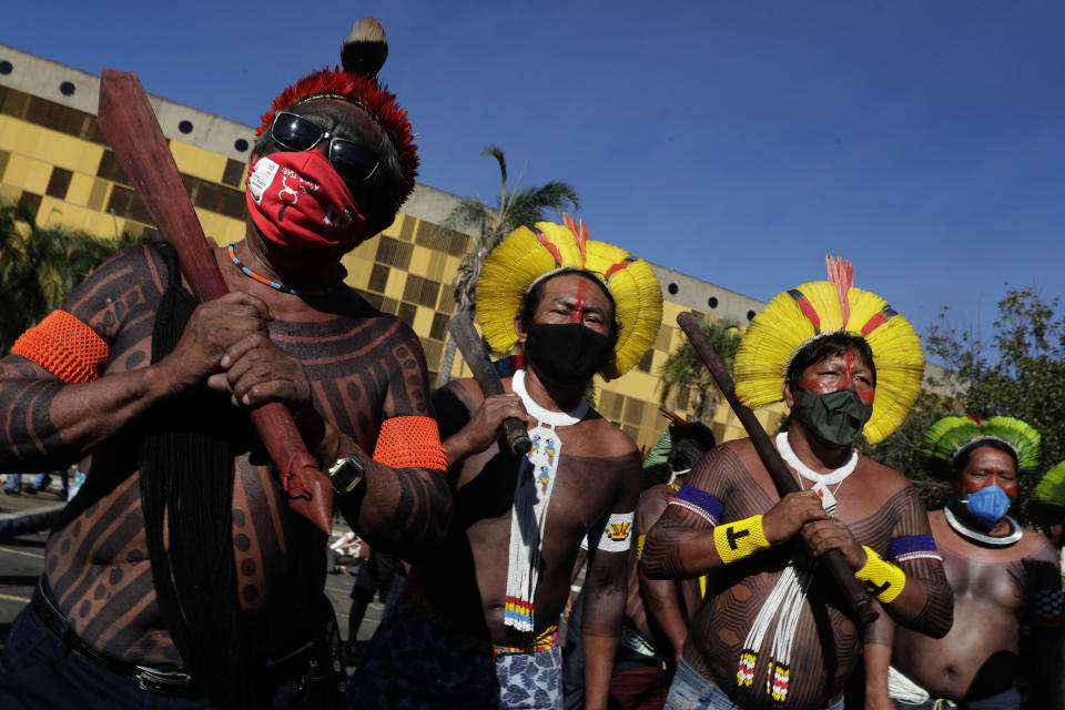 Indigenous people march to the entrance of the Chamber of Deputies to protest against Brazilian President Jair Bolsonaro's proposals to allow mining on Indigenous lands in Brasilia, Brazil, Wednesday, June 16, 2021. (AP Photo/Eraldo Peres)