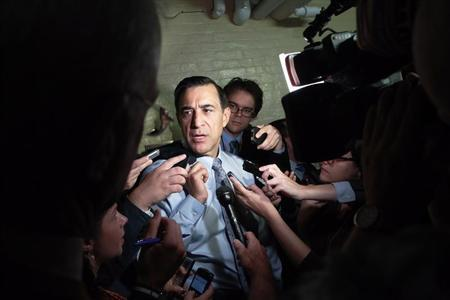 U.S. Representative Issa (R-CA) talks to reporters as he departs a House Republican caucus meeting at the U.S. Capitol in Washington