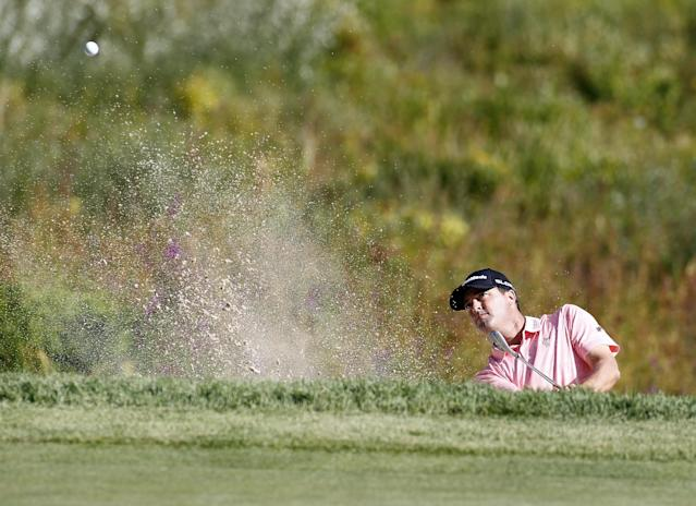 Ryan Palmer hits out of the sand trap on the third hole during the second round of the Deutsche Bank Championship golf tournament in Norton, Mass., Saturday, Aug. 30, 2014. (AP Photo/Stew Milne)