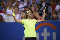 Lloyd Harris, of South Africa, reacts after he defeated Rafael Nadal, of Spain, at the Citi Open tennis tournament Thursday, Aug. 5, 2021, in Washington. Harris won 6-4, 1-6, 6-4. (AP Photo/Nick Wass)