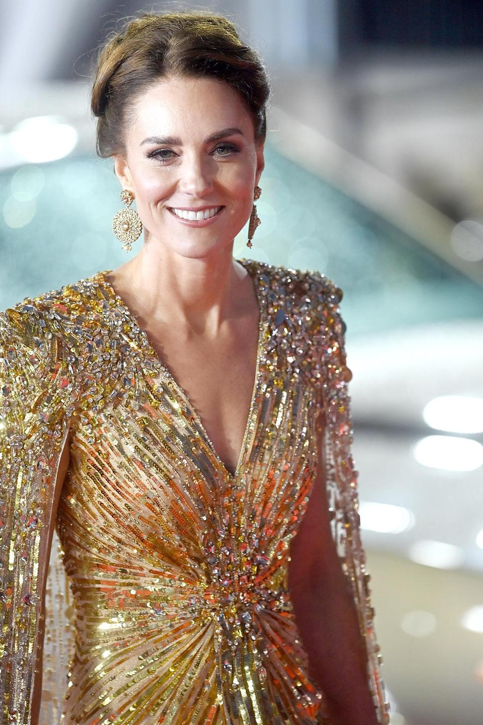 <p>To finish her look, Kate went with a neatly swept updo and earrings by London-based designer O'Nitaa. </p>