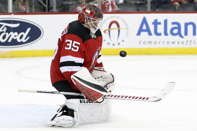 New Jersey Devils goaltender Cory Schneider makes the save against the New York Islanders during the third period of a preseason NHL hockey game, Saturday, Sept. 21, 2019, in Newark, N.J. The Devils won 4-3. (AP Photo/Mary Altaffer)