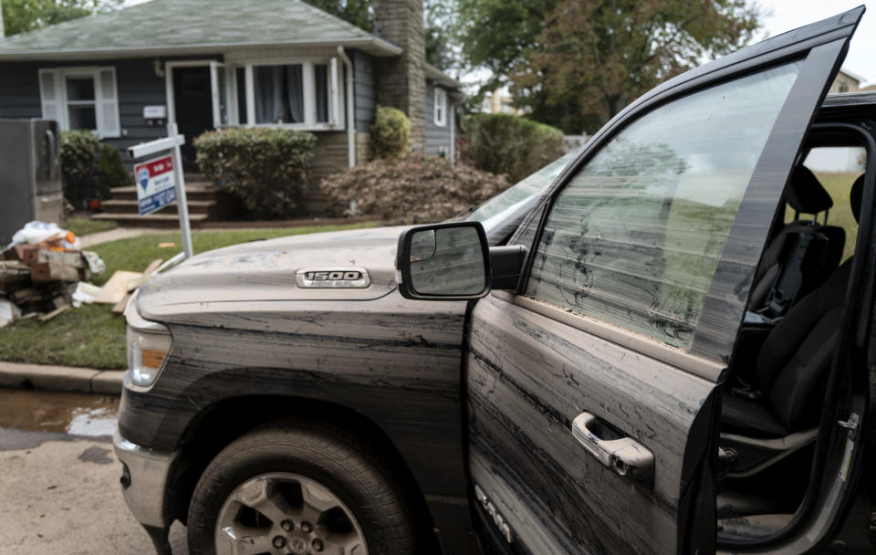 A truck belonging to Simon Wolyniec of Manville, N.J., shows the damage left behind Sunday, Sept. 5, 2021, in the wake of Hurricane Ida. Flood-stricken families and business owners across the Northeast are hauling waterlogged belongings to the curb and scraping away noxious mud as cleanup from Ida moves into high gear. (AP Photo/Craig Ruttle)