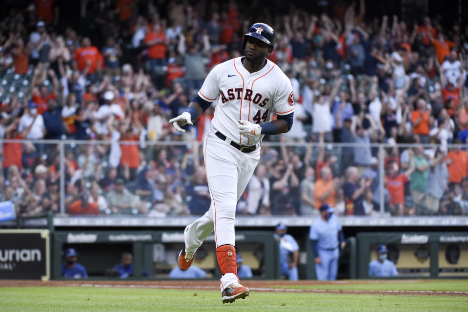 Houston Astros' Yordan Alvarez gestures toward the team's dugout while rounding the bases after hitting a two-run home run during the fourth inning of a baseball game against the Toronto Blue Jays, Saturday, May 8, 2021, in Houston. (AP Photo/Eric Christian Smith)