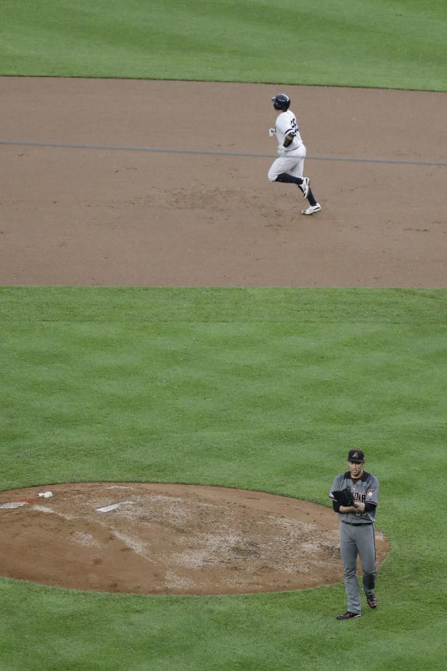 New York Yankees' Austin Romine (28) runs the bases after hitting a two-run home run as Arizona Diamondbacks relief pitcher Yoshihisa Hirano, of Japan, walks off the mound during the seventh inning of a baseball game Wednesday, July 31, 2019, in New York. (AP Photo/Frank Franklin II)