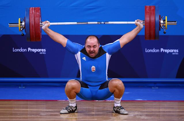 LONDON, ENGLAND - DECEMBER 11: Can Osman of Cyprus makes a lift in the Men's 105kg during the Weightlifting LOCOG Test Event for London 2012 at ExCel on December 11, 2011 in London, England. (Photo by Julian Finney/Getty Images)