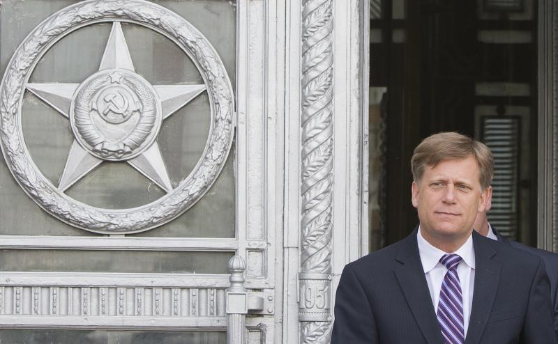 FILE - In this Wednesday, May 15, 2013 file photo the U.S. Ambassador to Russia Michael McFaul leaves the Foreign Ministry in Moscow, Russia. The U.S. ambassador to Russia has announced that he is stepping down after two turbulent years in Moscow. Michael McFaul is considered the architect of President Barack Obama's effort to reset relations with Russia. (AP Photo/Misha Japaridze, File)