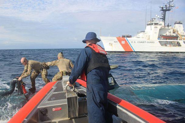 PHOTO: Members of a U.S. Coast Guard Cutter Valiant boarding team transfer narcotics between an interceptor boat and a suspected smuggling vessel in the Eastern Pacific in September 2019. (U.S. Coast Guard)