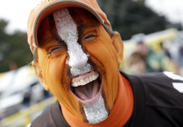 Cleveland Browns fan Bob Moore cheers before an NFL football game against the Green Bay Packers Sunday, Oct. 20, 2013, in Green Bay, Wis. (AP Photo/Tom Lynn)