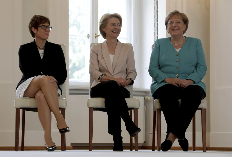 FILE - In this Wednesday, July 17, 2019, file photo, from right, German Chancellor Angela Merkel, new elected European Commission President Ursula von der Leyen and Annegret Kramp-Karrenbauer, von der Leyen's successor as German Defense Minister, attend an office over ceremony at the Bellevue Palace in Berlin, Germany, Wednesday, July 17, 2019.Ursula von der Leyen, a Merkel Cabinet stalwart, became the European Commission's first female president in 2019. Annegret Kramp-Karrenbauer succeeded Merkel as leader of her CDU in 2018, though she failed to impose her authority on the party and stepped down earlier this year. (AP Photo/Michael Sohn, File)