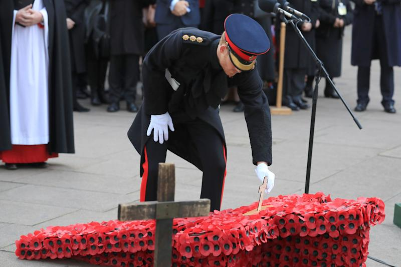 Prince Harry at Westminster Abbey's Field of Remembrance in London to honour the fallen ahead of Armistice Day: Gareth Fuller/PA