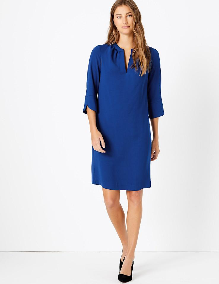 """Titled the """"Smart Set Capsule Collection,"""" the workwear pieces include a <a href=""""https://www.marksandspencer.com/us/crepe-shift-dress/p/P60277644.html"""" target=""""_blank"""" rel=""""nofollow"""">crepe shift dress from Marks & Spencer</a>which retails for just $32.50 and is available in three colors: black, red and blue. Described as a """"staple in your autumn wardrobe,"""" the knee-length dress has three-quarter length sleeves with a split mandarin collar and is iron-free."""