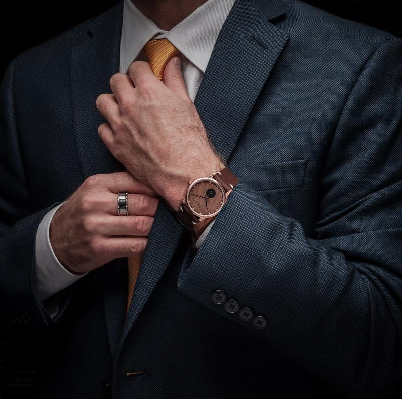"""<p><strong>AVANTwatches</strong></p><p>etsy.com</p><p><strong>$184.50</strong></p><p><a href=""""https://go.redirectingat.com?id=74968X1596630&url=https%3A%2F%2Fwww.etsy.com%2Flisting%2F640996406%2Fpersonalized-wooden-watch-o-engraved&sref=https%3A%2F%2Fwww.thepioneerwoman.com%2Fholidays-celebrations%2Fgifts%2Fg32268043%2Fgifts-for-husbands%2F"""" rel=""""nofollow noopener"""" target=""""_blank"""" data-ylk=""""slk:Shop Now"""" class=""""link rapid-noclick-resp"""">Shop Now</a></p><p>A wooden watch is pretty cool all on its own, but this personalized timepiece is even more unique. </p>"""
