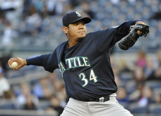 Seattle Mariners starting pitcher Felix Hernandez throws to a New York Yankees batter in the first inning of a baseball game at Yankee Stadium on Tuesday, May 14, 2013, in New York. (AP Photo/Kathy Kmonicek)