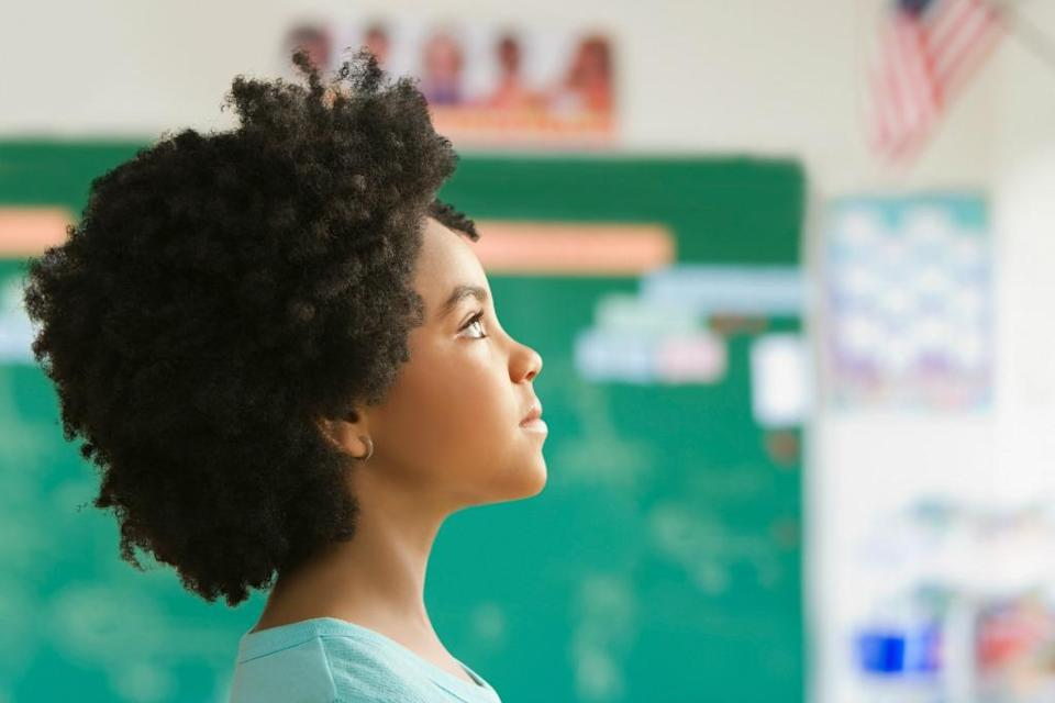 Lovely Hoffman, who is a teacher at Helen Y. Davis Leadership Academy in Dorchester, Mass., wrote a song to help inspire her female students to love their looks. (Photo: Getty)