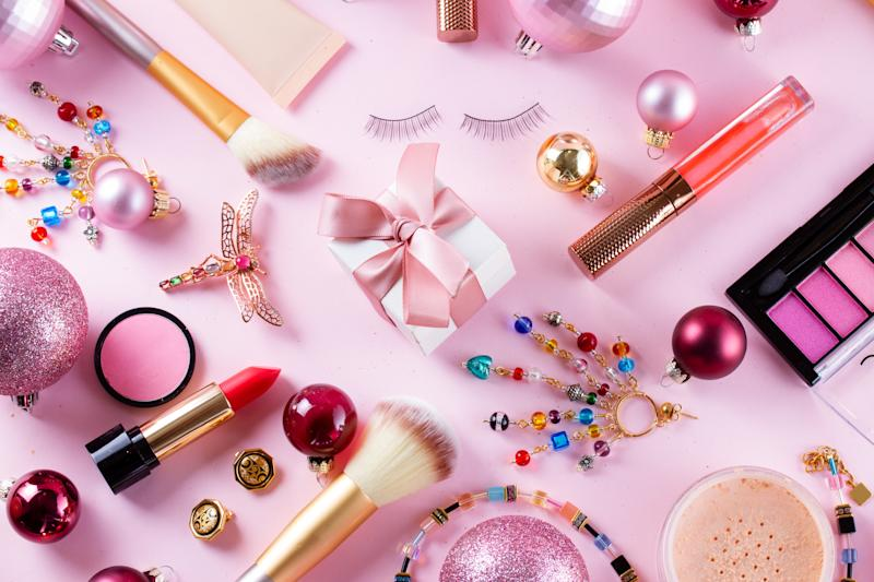 Festive make up products on pink background