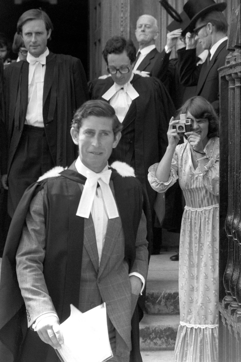 Prince Charles outside Senate House, Cambridge, after being awarded a Master of Arts degree from the university in 1975. He had previously graduated in 1970 with a 2:2 after three years of university. (PA Images)