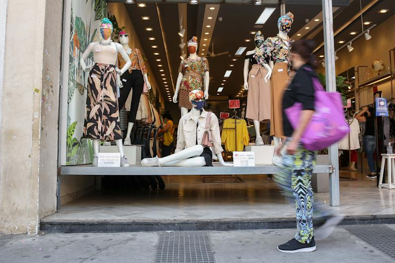 SAO PAULO, Aug. 12, 2020 -- A pedestrian passes by the showcase of a store in Sao Paulo, Brazil, Aug. 12, 2020. Brazil on Wednesday said it registered 1,175 deaths from the novel coronavirus COVID-19 in the previous 24 hours, raising the death toll to 104,201. According to the Brazilian Ministry of Health's daily pandemic report, tests detected 55,155 new cases of infection in the same 24-hour period, taking the total caseload to 3,164,785. A total of 2,309,477 patients have recovered. (Photo by Xinhua/Xinhua via Getty) (Xinhua/ via Getty Images)